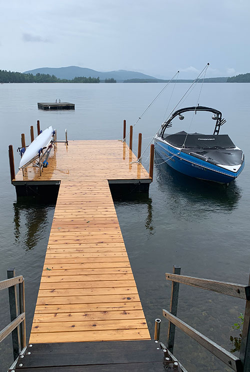 Floating dock with boat whips and kayak rack